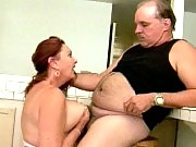 Redhead granny titty fucking in the kitchen