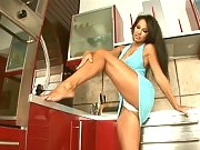 Exotic busty Pocahontas posing in the kitchen