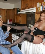 Busty Estrella Flores spreading her legs wide in her kitchen table to let her partner admire her feet