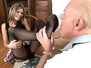 Natalie Sky bends over to have her stockinged pretty feet and toes licked